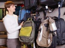 Man choosing a satchel Stock Image