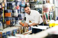 Man choosing sealant tube Royalty Free Stock Images