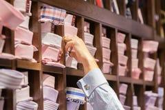 Man Choosing A Shirt Royalty Free Stock Photos