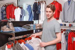 Man choosing shirt for himself in boutique Royalty Free Stock Images