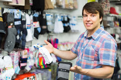 Man choosing socks at the shop Royalty Free Stock Photography