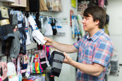 Man choosing socks at the shop Stock Images