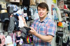 Man choosing socks at the shop Stock Image