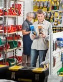 Man Choosing Soldering Iron In Store Royalty Free Stock Photography