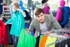 Man  choosing a sport shorts in the shop Royalty Free Stock Photos