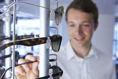 Man Choosing Sunglasses In Shop Royalty Free Stock Photo