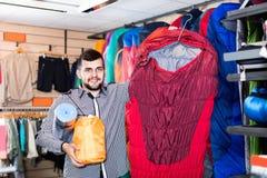Man choosing touristic equipment in sports equipment store Stock Photo