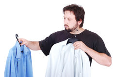 Man choosing between two shirts. White elegant man with two fasion shirts in hands Stock Photos