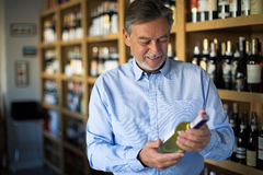 Man choosing wine. Portrait of sommelier in wine store Royalty Free Stock Photos