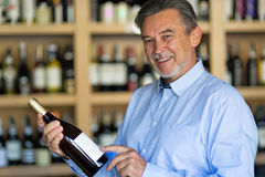 Man choosing wine. At shop Stock Images
