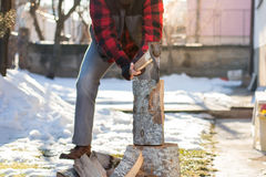 Man chopping firewood in the yard Royalty Free Stock Images