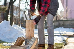 Man chopping firewood in the yard Stock Photos