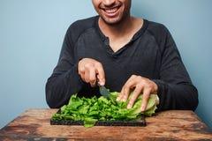 Man chopping lettuce Stock Image