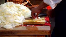 Man chopping onions