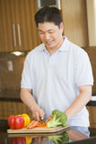 Man Chopping Vegetables Stock Photo
