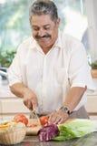 Man Chopping Vegetables Royalty Free Stock Photo