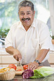 Man Chopping Vegetables Stock Photography