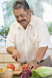Man Chopping Vegetables Stock Images