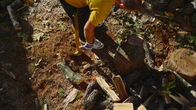 Man Chopping Wood With An Axe stock video footage