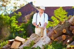 Free Man Chopping Wood On The Backyard Royalty Free Stock Image - 44478026