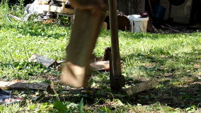 Man Chopping Wood Outdoors With Axe stock video footage