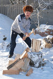 Man chopping wood in winter Cleaver. Man chopping wood for the stove in winter Cleaver bath Stock Images