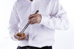 Man with chopsticks eat egg springroll. Isolated on white Royalty Free Stock Photography