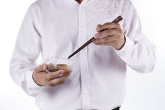 Man with chopsticks eat egg springroll. Isolated on white Stock Photo