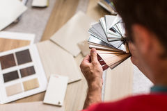 Man chosing the right flooring for his house. /appartement stock photo