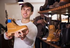 Man are chosing the shoe Stock Images