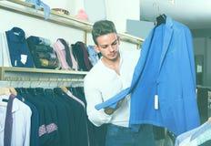 Man chousing jacket Royalty Free Stock Images