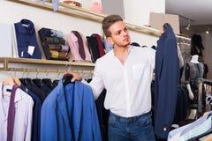 Man chousing jacket Royalty Free Stock Image