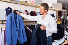 Man chousing jacket Stock Photography