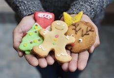 Man with christmas cookies Stock Photos