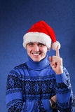 Man in christmas hat Stock Image