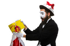 Man with christmas hat and a gift in their hands Royalty Free Stock Image
