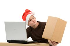 Man with christmas hat and laptop Stock Images