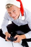 Man with christmas hat and playing video games Stock Photos