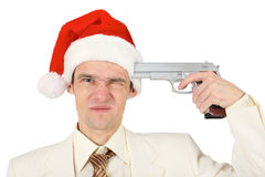 Man in Christmas hat tries to shoot himself Stock Images