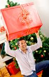 Man with a Christmas present Royalty Free Stock Photos