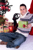 Man Christmas present home Stock Photography