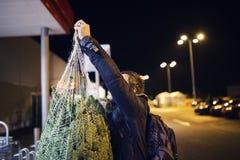 Man with christmas tree Stock Photos