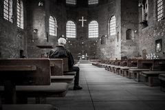Man in church in black and white Stock Photos