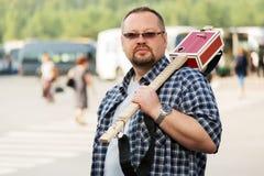 Man with a cigar box guitar Royalty Free Stock Photo