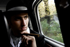 Man with cigar in the car Stock Photos