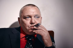 Man with cigar closeup Royalty Free Stock Image