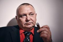 Man with cigar closeup Stock Image