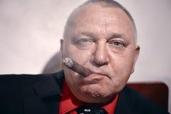 Man with cigar closeup Stock Photos