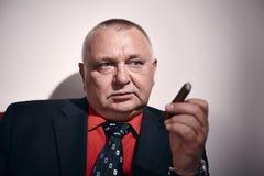 Man with cigar closeup Royalty Free Stock Images