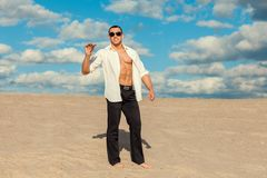 Man with cigar in the desert. Stock Images